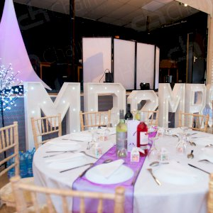 The new Mr & Mrs with the help of Chair Hire.