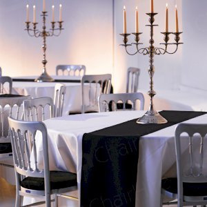 Exquisite venue themes with banquet chairs, runners & linen.