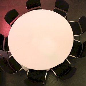 Team black conference chairs with white linen for smart elegance.