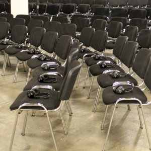 Stacking chairs set up & prepared for the event.