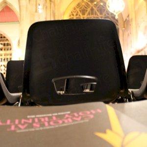 Black seating at fundraising carol concert.