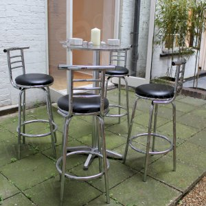 Cocktail tables and stools for your networking event.