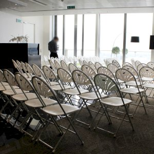 Folding fan back chairs are a popular choice at meetings and conferences. (HC76)