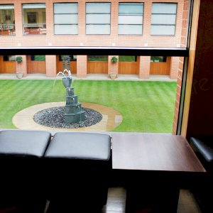 Walnut coffee tables and cube seating for other areas of your seminar/event.