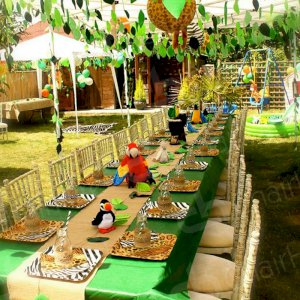 1830 trestle tables and limewash chiavari chairs used to create your own safari event.