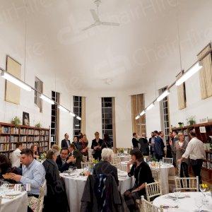 fully dressed banqueting tables with elegant limewash chiavari chairs