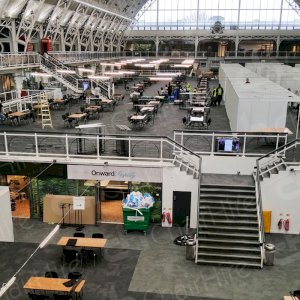 Wide angle shot of London's Olympia preparing for the 2018 Textile Fair. Hired furniture being put in place for all the attendants.