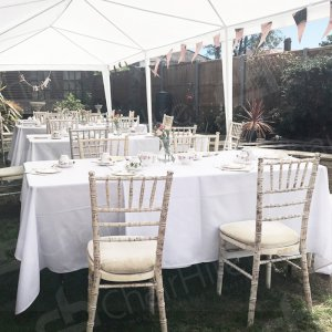 Complete the party with dressed tables and Chiavari chairs, housed under a white gazebo.