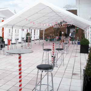 Poseur tables and stools at outdoor events set the perfect scene.