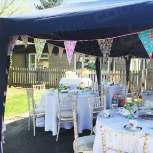 Transform any event space with tables and chairs finished with clean white table linen. Bunting completes the look and adds a splash of colour.