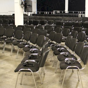 Hire stacking chairs with linking loops.