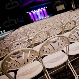 Thousands of folding chairs for arena occasion.