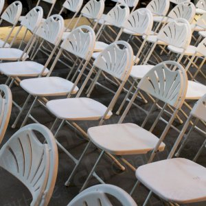 White folding chairs for quick, modern looking seating.