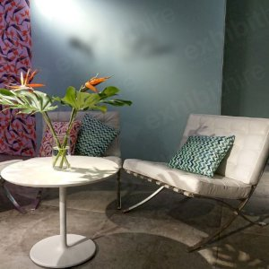 The Barcelona Chair has luxurious white leather material and is extremely comfortable.