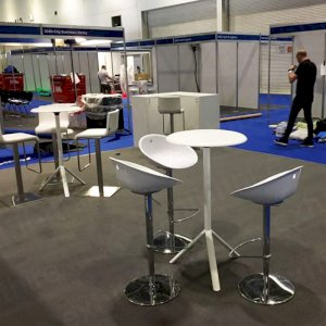 Our White Gliss Stools (in the front right of the photo) with a Mara Table.