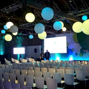 Our Globes hang from the ceiling and can be illuminated in a range of colours.