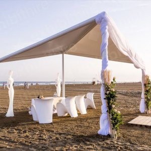 Our Tetra Pergola made an eye-catching and stylish structure at this beach event, paired with our Grace figure and Evie chairs.